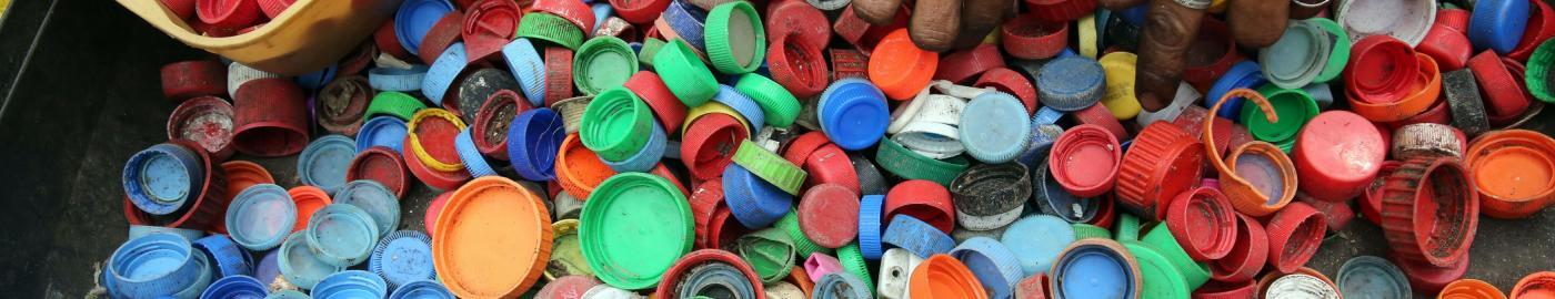 hands in bottle caps