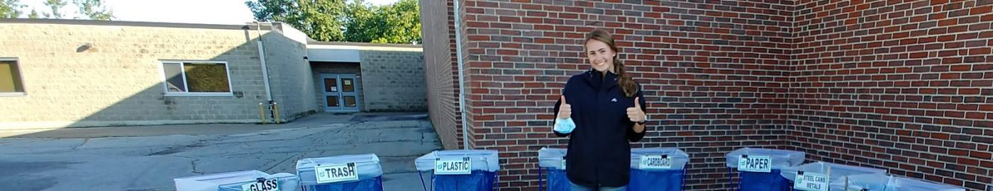 Student with recycling bins