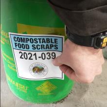 Permit on compost pail
