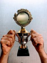 Hands holding trophy