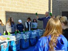 Students sort into bins