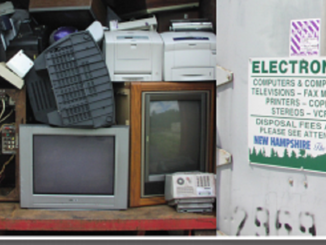 A neat pile of electronic equipment waste