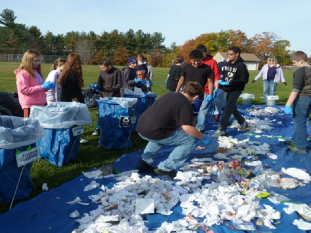 Students sorting  recycling on a lawn